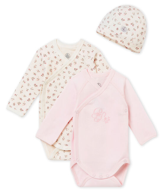A newborn's gift set with two long sleeved bodysuits and a hat . set